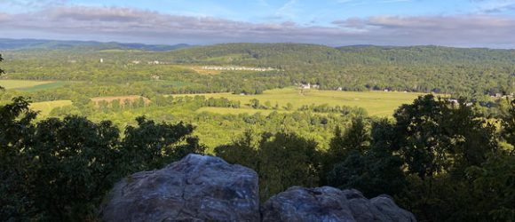 View over hills and valleys from a rocky outcrop