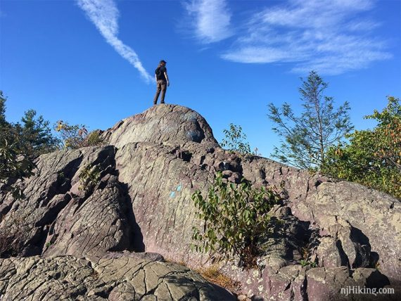 Hiker standing on a protruding fin of rock