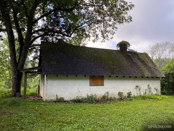 White farm building with dark roof