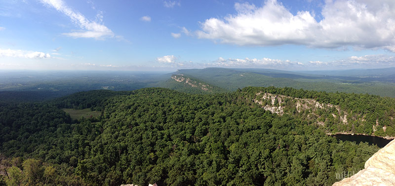 Panoramic view over green forest and white cliffs of New York's Shawangunks