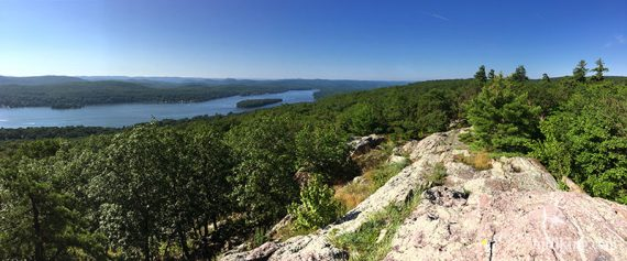Wide view of Greenwood lake with a rock slab in the foreground
