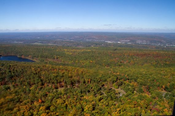 Looking down on foliage covered hills of NJ and PA