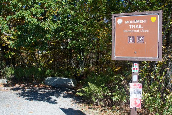 Monument Trail sign at the end of the parking lot