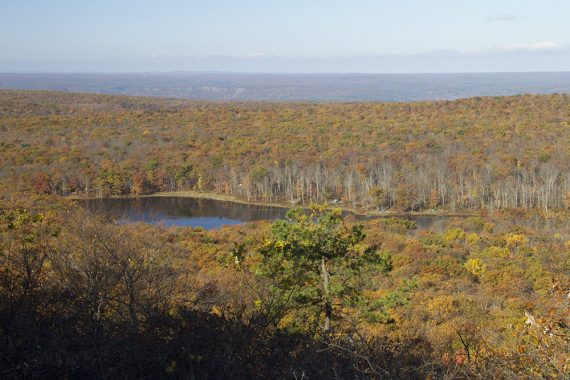 Sawmill Lake in the distance surrounded by fall foliage