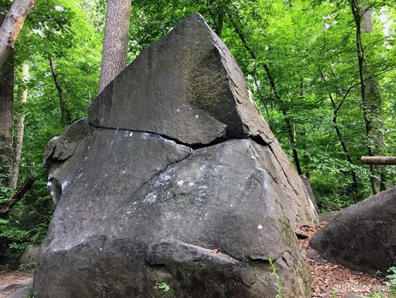 Large very angled boulder that comes to a point at the top