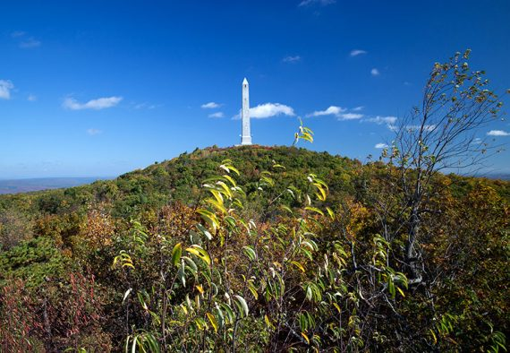 High Point monument on top of a hill seen from the viewing platform along the Appalachian Trail