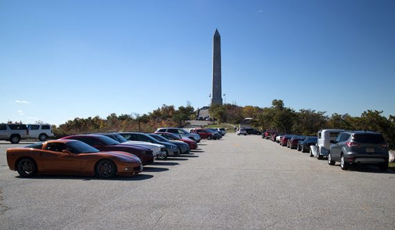 High Point monument at the end of a parking lot filled with cars