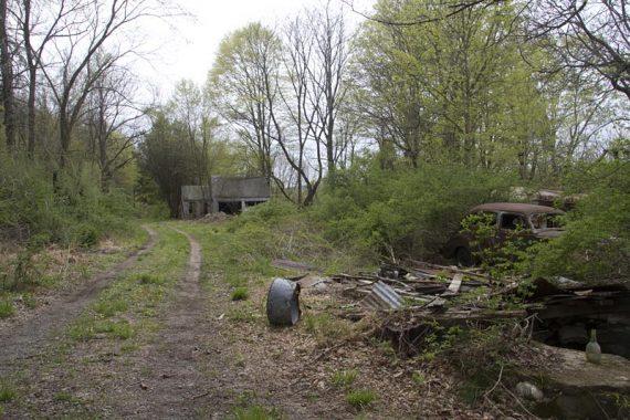 Pioneer Trail (Orange) hikes past abandoned buildings....
