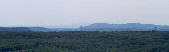 New York City skyline seen in the far distance from a viewpoint