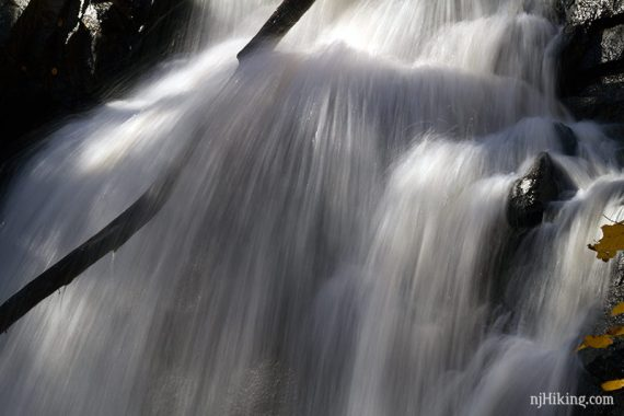 Close up of heavy water flowing over rocks