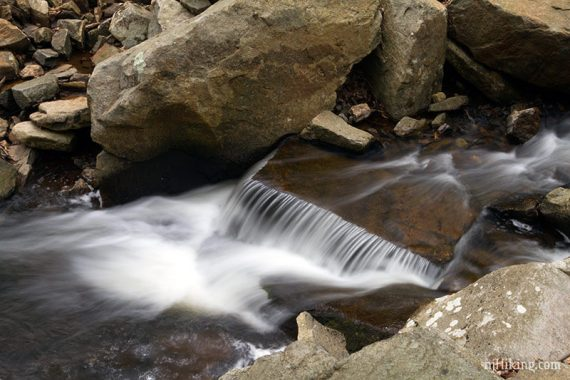 Water cascading over an angled rock