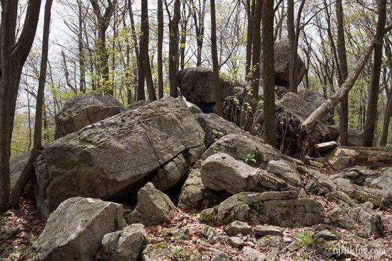 Large pile of boulders on a trail