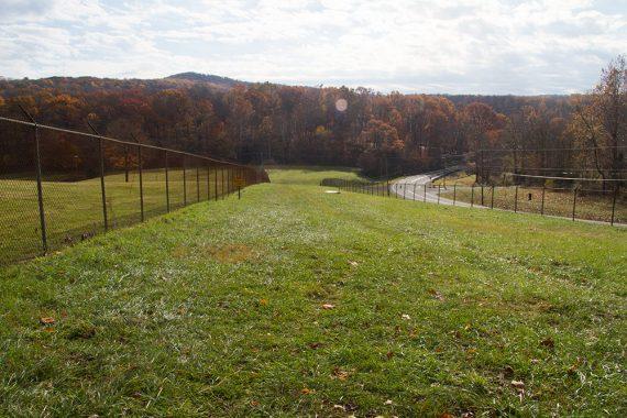 Crossing the grassy area near the dam