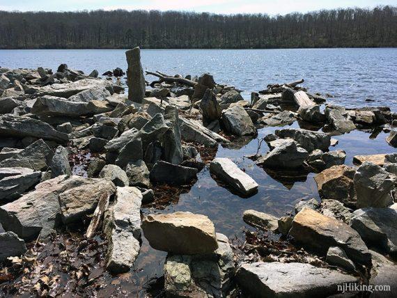 Jumble of rectangular rocks near a pond