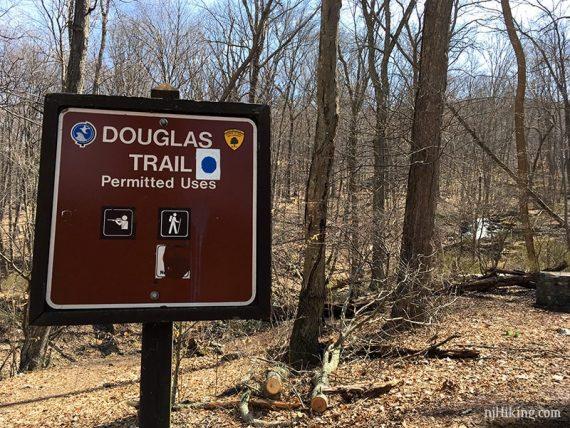 Douglas Trail sign with Laurel Falls beyond.