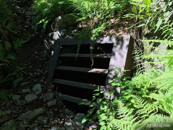 Small mine entrance covered with metal, 2019