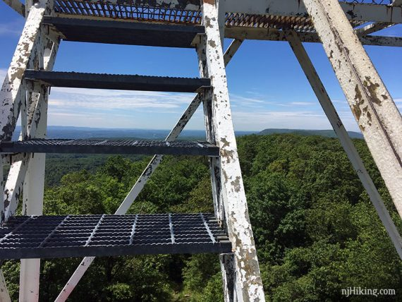 Looking through open metal steps of Catfsh fire tower
