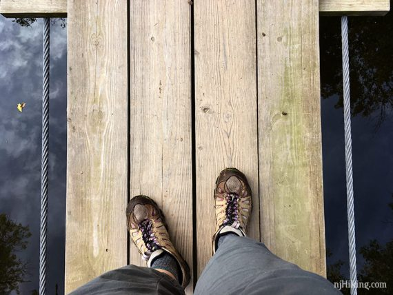 Looking down while crossing the swinging bridge