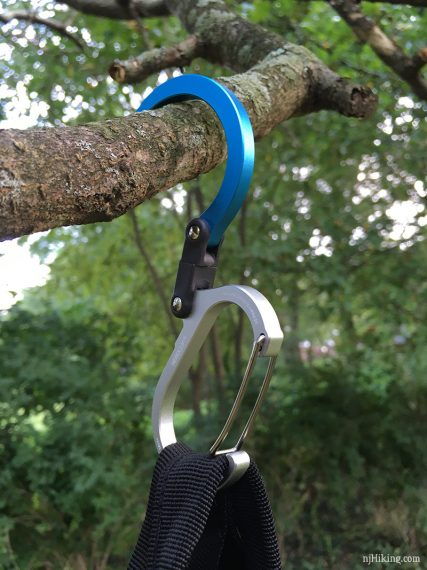 Hero Clip hanging a bag on a branch