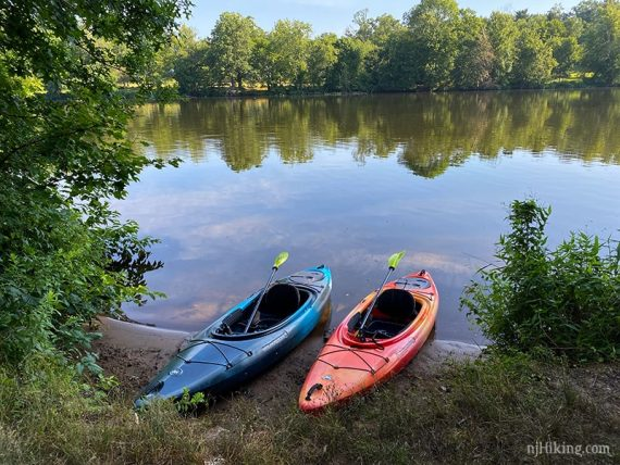 Two kayaks at the edge of the lake