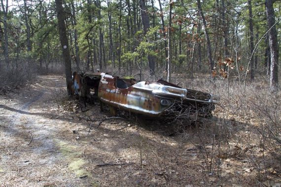 Rusted out car chassis along the trail