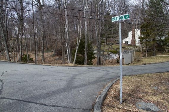 The WHITE trail heads through several streets in a neighborhood