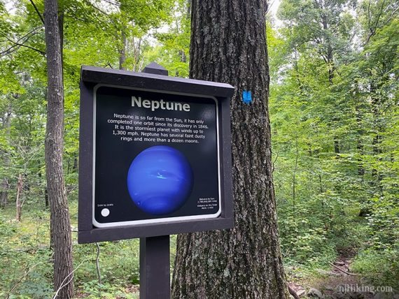 Planet Walk sign with facts and a picture of Neptune