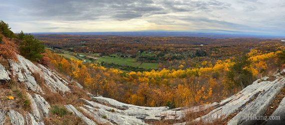Panoramic view from a rock ridge of foliage and farms below