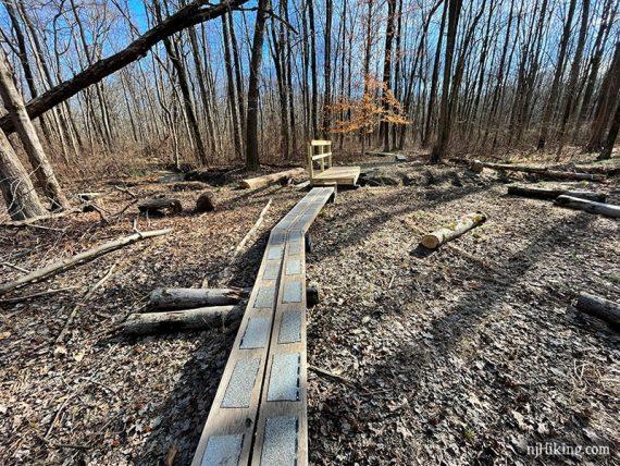 Plank puncheons approaching a wooden footbridge