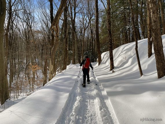 Snowshoeing in wide snowy tracks