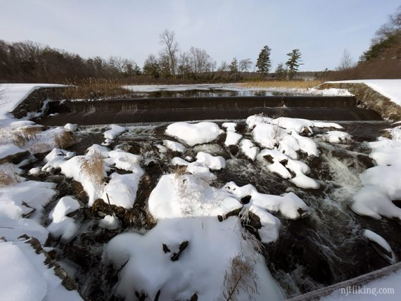 Snow and ice covered dam