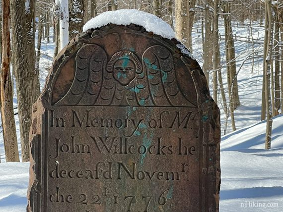Old gravestones with snow