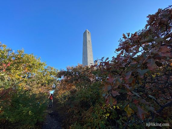 Hiker approaching High Point Monument from below