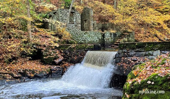 Ruins of Kay's Cottage and water cascading over a dam