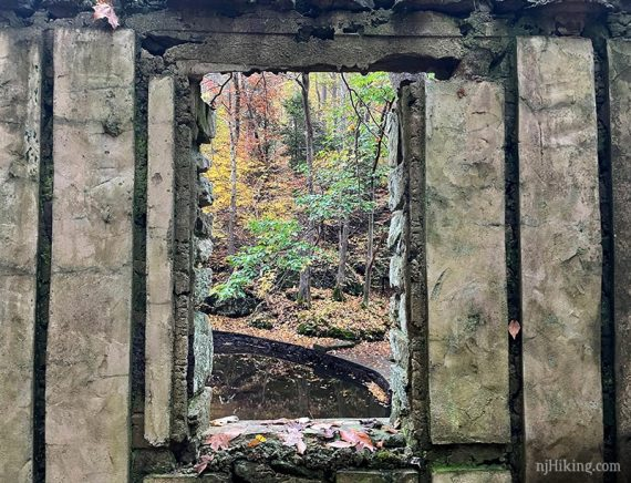 Looking through a window in a stone wall.