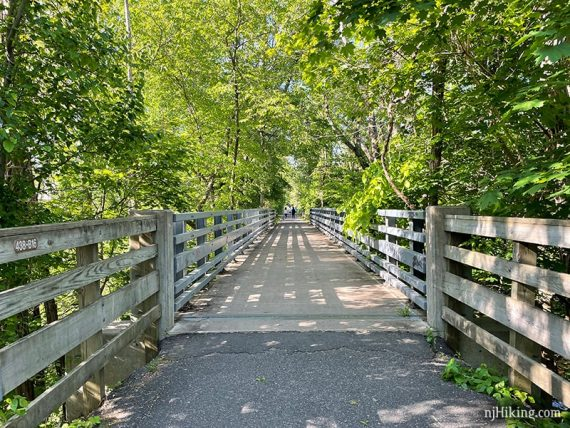 Fence along a paved rail trail