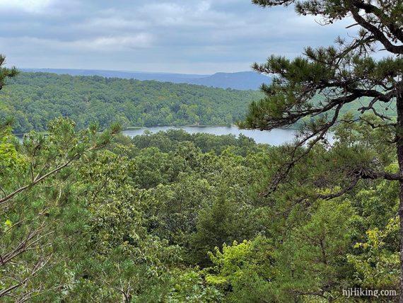 Ramapo Lake seen beyond green trees