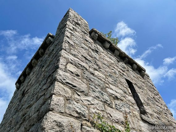 Looking up at a stone water tower